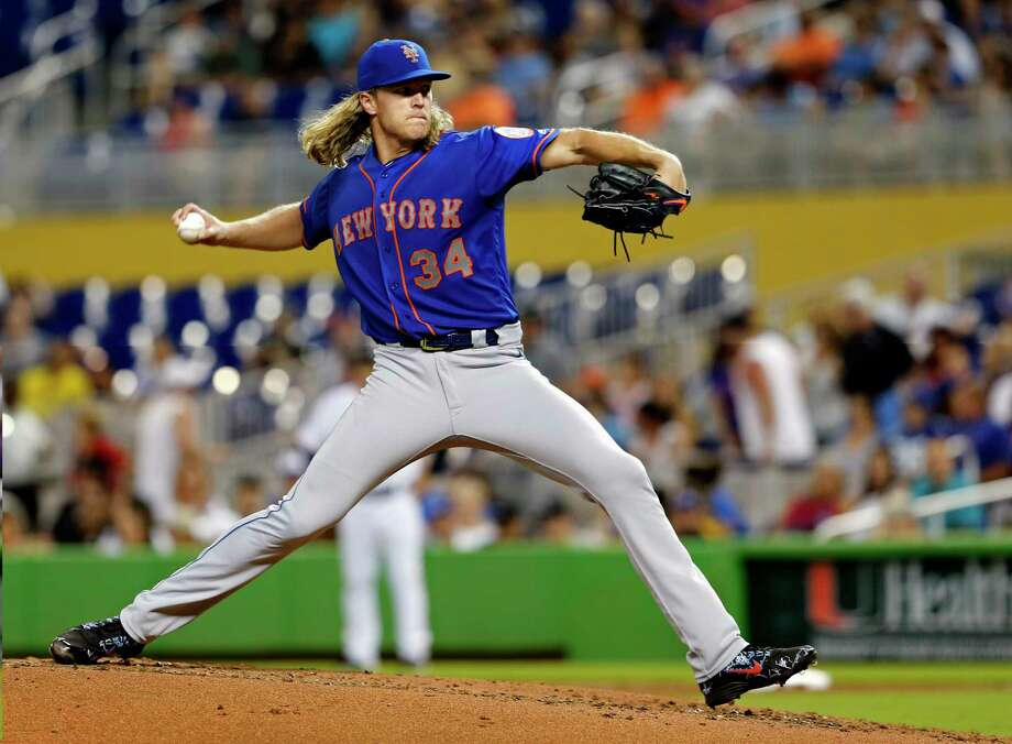 New York Mets starting pitcher Noah Syndergaard throws against the Miami Marlins in the fourth inning during their baseball game in Miami, Sunday, Aug. 12, 2018. (AP Photo/Joe Skipper) Photo: Joe Skipper / FR171174 AP