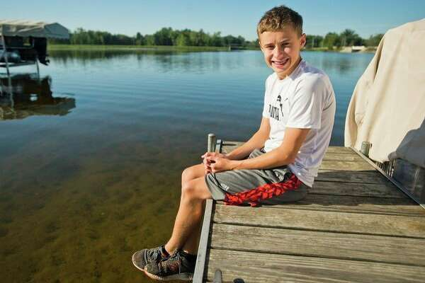 Tommy Roenicke, 13, poses for a portrait at Wixom Lake on Friday. Roenicke recently helped a younger boy to safety who was struggling in deep water at the lake. (Katy Kildee/kkildee@mdn.net)