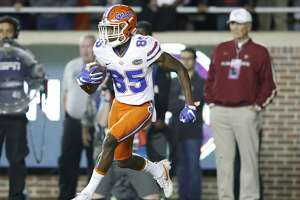 TALLAHASSEE, FL - NOVEMBER 26: Chris Thompson #85 of the Florida Gators runs with the ball against the Florida State Seminoles during the game at Doak Campbell Stadium on November 26, 2016 in Tallahassee, Florida. Florida State defeated Florida 31-13. (Photo by Joe Robbins/Getty Images)