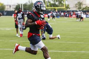 Houston Texans wide receiver DeAndrew White (11) makes a catch while working with the Texans quarterbacks during training camp at the Methodist Training Center on Saturday, Aug. 11, 2018, in Houston.