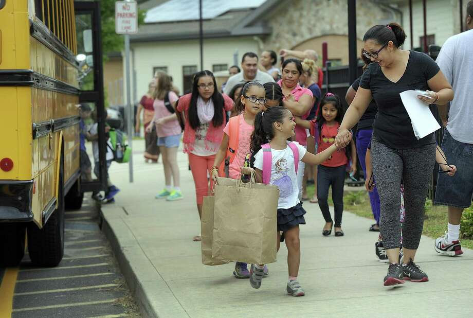 Emilia Ortega, 4, holds her mother Luisana's hand, as she arrives for the first day of school at Ellsworth Avenue Elementary in Danbury, Monday, August 29, 2016. Behind her is sister Camila, 8. Photo: Carol Kaliff / Hearst Connecticut Media / The News-Times