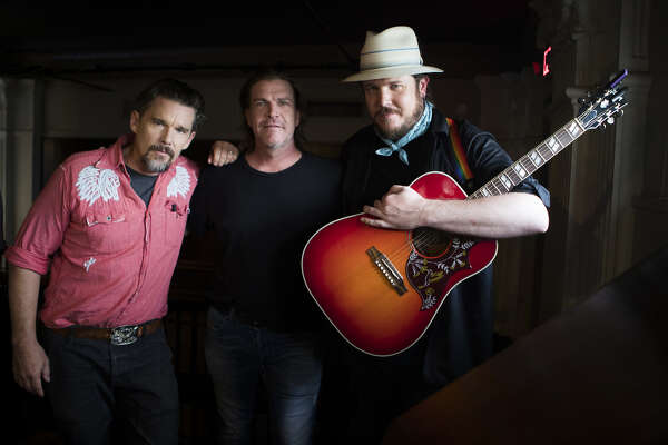 "Ethan Hawke, director of the film ""Blaze"" with singer-songwriter Jack Ingram and actor Ben Dickey at Rockefeller's in Houston, Aug. 12, 2018."