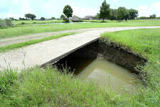 A portion of the throroughfare through the Babe Zaharias Memorial Golf Course is closed off after a broken drainage pipe led to a massive sinkhole opening up beneath the pavement. Problems at the course are among the repair issues facing the Port Arthur City Council as they seek to address the flooding and drainage problems throughout the city. The pipes running through the course haven't been replaced since the facility was built 50 years ago and several have broken, creating overflow to retention ponds and opening sinkholes at spots throughout the course. Friday, August 10, 2018 Kim Brent/The Enterprise
