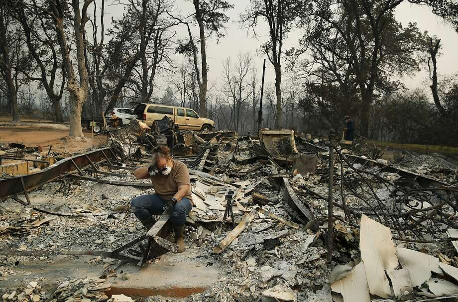 Kim Burns sits in the charred rubble of her home burned in the Carr Fire, Sunday, Aug. 12, 2018, in Redding, Calif. Photo: John Locher / Associated Press