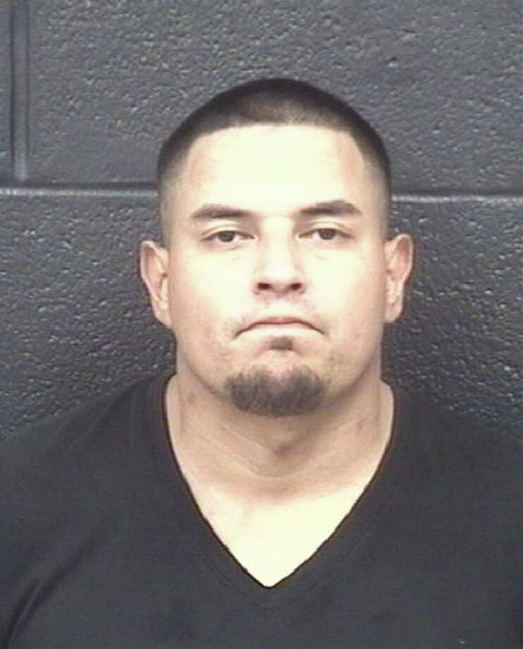 Julio Ernesto Rodriguez, 34, has an arrest warrant for aggravated robbery and evading arrest. Photo: Laredo Police Department