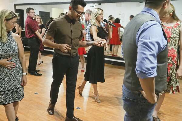 JK Dance Center owner Kelsey Tanner and Dancing with the Stars dance friend Paul Barris lead a group class 08/10/18 evening during the grand opening of the dance center. Tim Fischer/Reporter-Telegram