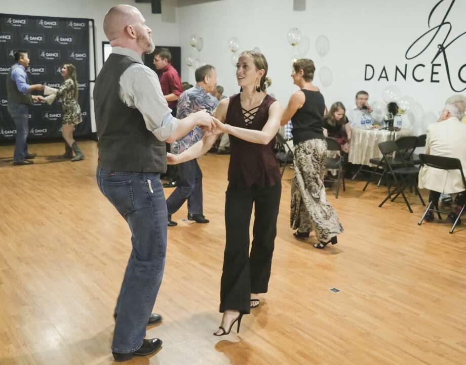 Dance patrons take to the floor at JK Dance Center before owner Kelsey Tanner and Dancing with the Stars dance friend Paul Barris lead a group class 08/10/18 evening during the grand opening of the dance center. Tim Fischer/Reporter-Telegram Photo: Tim Fischer/Midland Reporter-Telegram