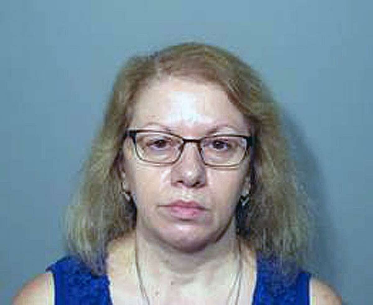 Joanne Pascarelli, 61, of Stratford, turned herself into New Canaan police Sunday, Aug. 12, 2018, and along with her sister and was charged with allegedly stealing nearly a half-million dollars from the New Canaan Public Schools' cafeterias.
