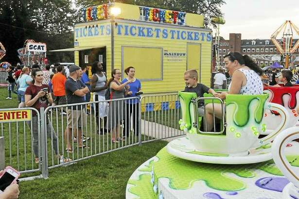 Above, residents enjoy the 2017 Winsted Fireman's Carnival, which begins Wednesday, Aug. 16 and continues through Saturday, Aug. 19 with rides, games, food, bingo and raffles, as well as a large fireman's parade and fireworks on Saturday night.