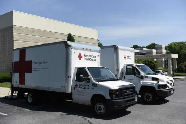 Red Cross trucks sit in the parking lot during a blood drive in Greenwich. Blood drives continue around the state this month. The Red Cross says it is facing a shortage after a very busy summer and encourages eligible donors to sign up.