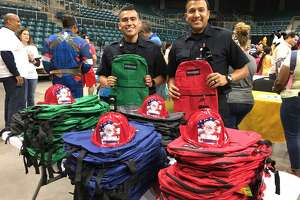 Helping to make sure that youngsters have a good start to the school year were Katy Fire Department firefighters and EMTs Enrique Escobedo and Julio Garcia. In addition to picking their favorite backpack, youths also could choose a fire helmet.