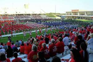 Bands, football teams and cheerleaders from all Katy ISD high schools prepare for the dedication ceremony at Katy ISD's Mike Johnson Field and Legacy Stadium in Katy, TX on August 17, 2017.