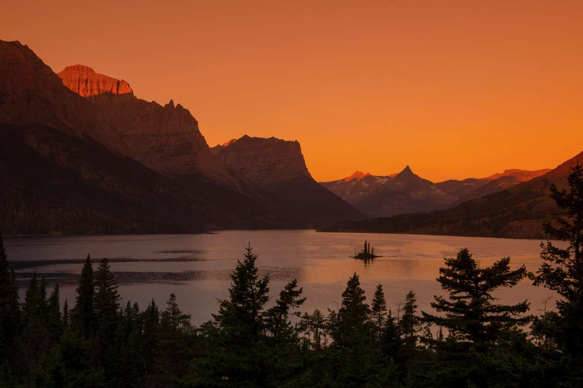 Wild Goose Island is seen in Saint Mary Lake at sunrise in Glacier National Park, Mont.