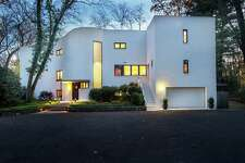 Built in 1938, Arthur Holden, who worked with Frank Lloyd Wright on the Guggenheim, designed the three-bedroom contemporary at 27 Tory Hole Road in Darien.