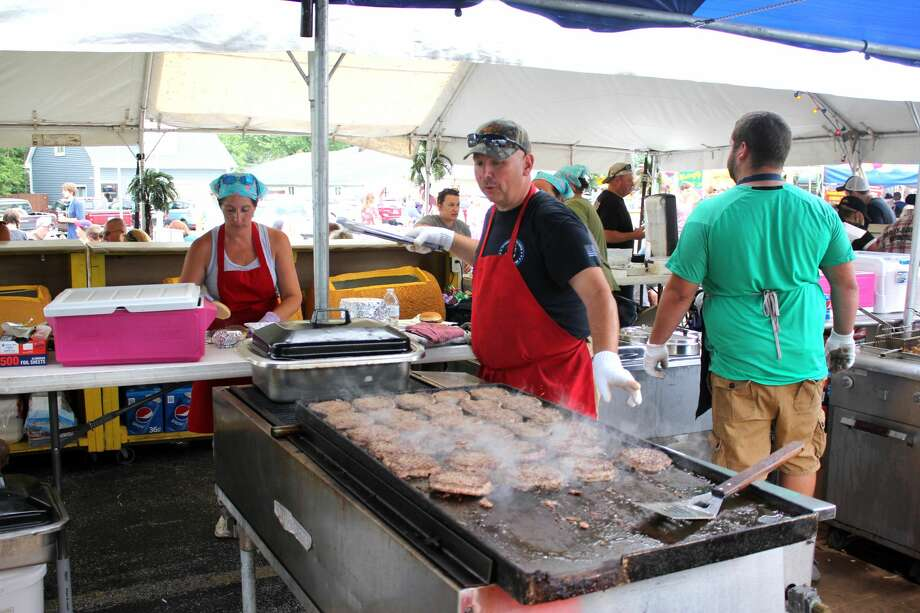 Scott Jobes grills up a few burgers Saturday at Hot Rod's Angus Burgers as part of the 20th annual Cheeseburger in Caseville Festival, which kicked off over the weekend. Photo: Brenda Battel/Huron Daily Tribune