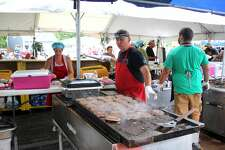 Scott Jobes grills up a few burgers Saturday at Hot Rod's Angus Burgers as part of the 20th annual Cheeseburger in Caseville Festival, which kicked off over the weekend.