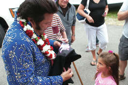 Steve Davis, as Elvis, signs an autograph at a previous Fall Festival.