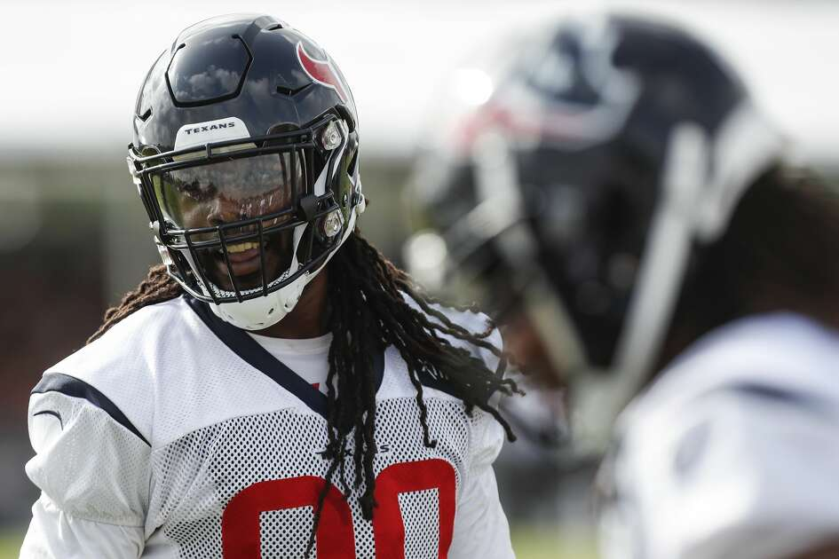 Houston Texans defensive end Jadeveon Clowney (90) finishes a drill during training camp at the Methodist Training Center on Monday, Aug. 13, 2018, in Houston.