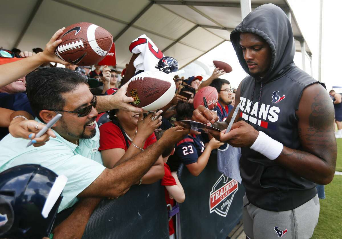 Houston Texans quarterback Deshaun Watson signs autographs following practice during training camp at the Methodist Training Center on Monday, Aug. 13, 2018, in Houston.