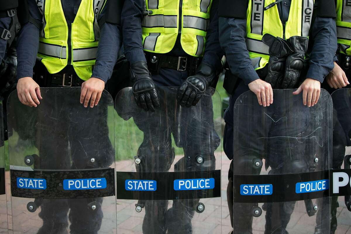 Virginia State Troopers stand down during a rally on the campus of The University of Virginia one-year after the violent white nationalist rally that left one person dead and dozens injured, in Charlottesville, Virginia on August 11, 2018. - US President Donald Trump, often accused of denigrating non-white people, condemned racism Saturday as the nation marked the anniversary of deadly unrest triggered by a neo-Nazi rally in Charlottesville, Virginia. That protest left one person dead and highlighted the growing boldness of the far right under Trump. Another far-right rally is scheduled for Sunday, right outside the White House. (Photo by Logan Cyrus / AFP)LOGAN CYRUS/AFP/Getty Images