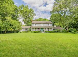 The quintessential New England colonial house at 1 Barry Lane sits on a cul-de-sac on a level property of one acre.
