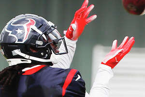 Houston Texans wide receiver Sammie Coates (18) reaches over his shoulder to make a catch during training camp at the Methodist Training Center on Monday, Aug. 13, 2018, in Houston.