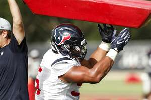 Houston Texans defensive end Christian Covington (95) hits a blocking dummy during training camp at the Methodist Training Center on Monday, Aug. 13, 2018, in Houston.