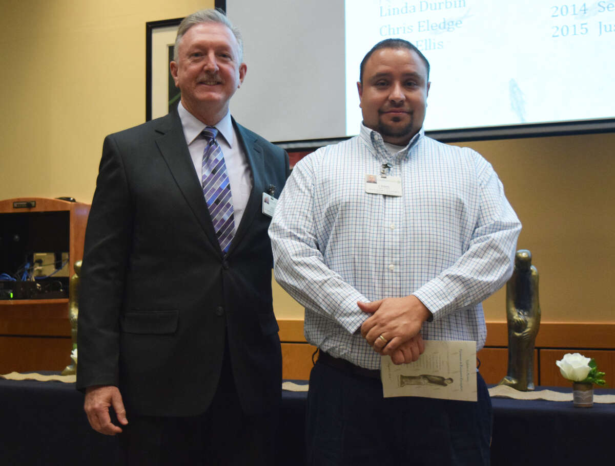 Chris Lopez, cafeteria manager for Covenant Health Plainview, and his team was honored withthe Value of SERVICE award by the St. Joseph medical group.