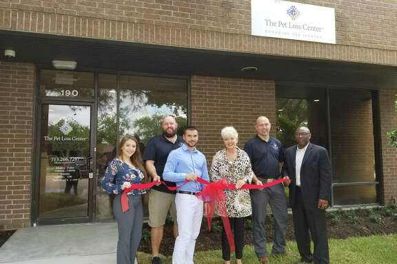 The Pet Loss Center has recently opened up at 10645 Richmond Ave., Ste. 190. Co-founder Coleen Ellis (middle) stands with her team at the grand opening. The company offers a wide range of end of life services for pets, including viewing rooms, memorialization products and cremation services.