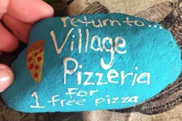 The Village Pizzeria, 638 N. Center St., Sebewaing, is among those who have joined in hiding painted rocks. The pizzeria is using rocks as a marketing tool by offering a free menu item to those who find it and return it. (Submitted Photo)