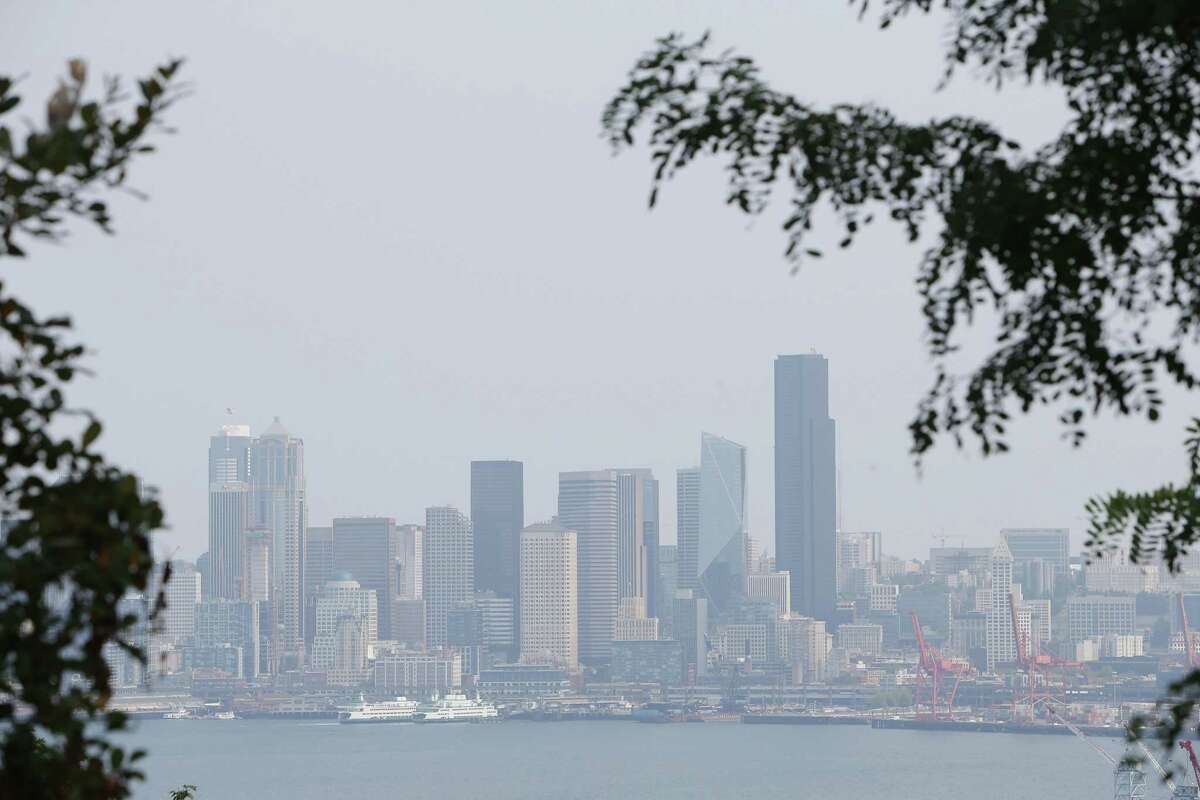 Wildfire smoke from British Columbia causes a haze over the Seattle skyline, Monday, Aug. 13, 2018.