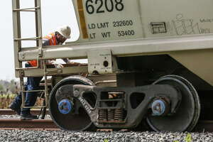 A man looks at a set of train car wheels, which derailed while traveling next to U.S. Highway 90 near Easton Avenue Monday Aug. 13, 2018 in Sugar Land. The derailed train damaged multiple crossings as it traveled several miles through downtown Sugar Land.