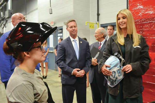 Assistant to the President Ivanka Trump and Congressman Rodney Davis toured the Weber Workforce Center Wednesday, Aug. 8, during Davis' Workforce Roundtable event on Lewis and Clark Community College's Godfrey Campus. Trump tried her hand at welding during the tour and is shown here speaking with L&C Welding Alumna Isabella Stockton.