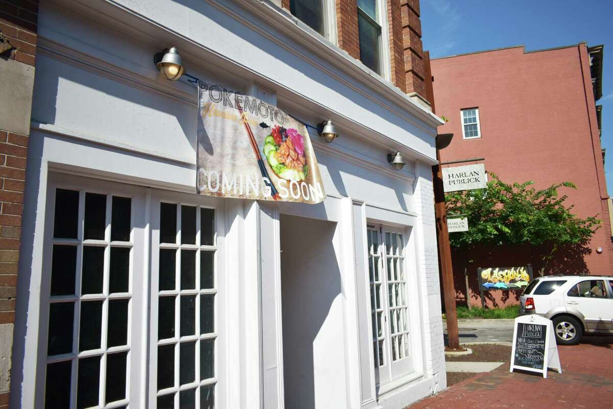 """A """"coming soon"""" sign for Pokemoto is displayed in mid-August 2018 at 133 Washington St. in South Norwalk, Conn., with the chain having a Fairfield location serving the Hawaiian raw fish delicacy poke."""