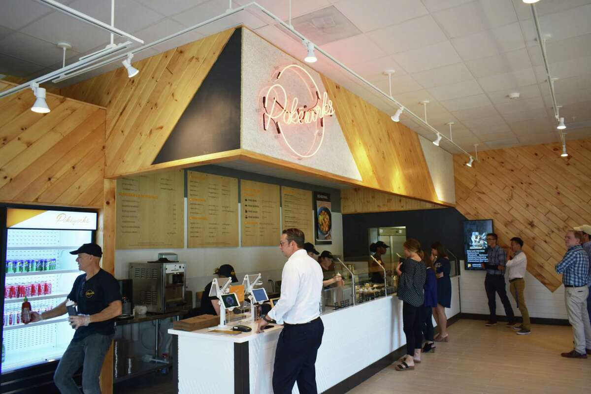 Diners line up on Aug. 6, 2018 at Pokeworks new restaurant at 14 Danbury Road in Wilton, Conn.