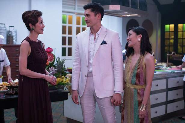"Michelle Yeoh as Eleanor, Henry Golding as Nick and Constance Wu as Rachel in Warner Bros. Pictures' and SK Global Entertainment's and Starlight Culture's contemporary romantic comedy ""Crazy Rich Asians,"" a Warner Bros. Pictures release."