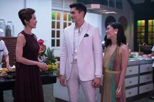 """Michelle Yeoh as Eleanor, Henry Golding as Nick and Constance Wu as Rachel in Warner Bros. Pictures' and SK Global Entertainment's and Starlight Culture's contemporary romantic comedy """"Crazy Rich Asians,"""" a Warner Bros. Pictures release."""