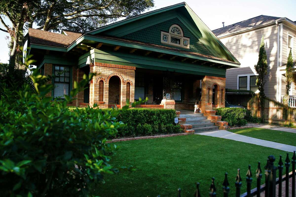 Their historic Heights home has green trim, perfect for their bright new lawn.