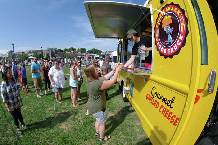 Customers are served at The Cheese Shack truck during last year's Alton Food Truck Festival. Photo:       David Blanchette | For The Telegraph