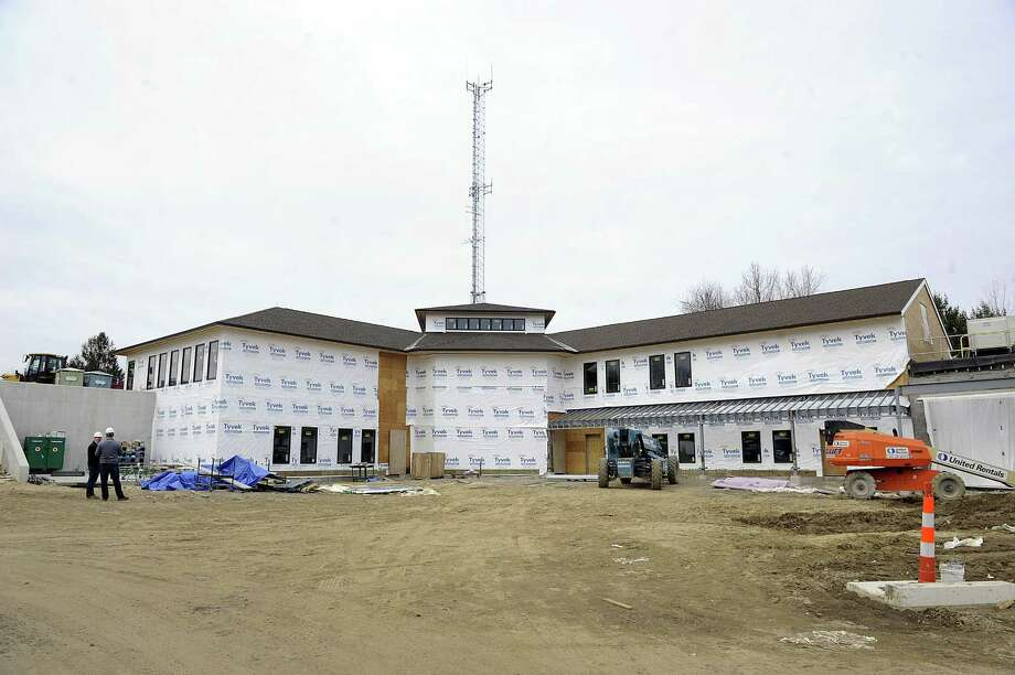 Work continues on the building of the new Bethel Police Headquarters Wednesday, March 28, 2018. The project is more than $888,000 over budget. Photo: Carol Kaliff / Hearst Connecticut Media / The News-Times