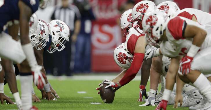 A view down the line of scrimmage as the Katy Tigers attempt a field goal during the high school football playoff game between the Atascocita Eagles and the Katy Tigers at NRG Stadium in Houston, TX on Saturday, December 1, 2017.