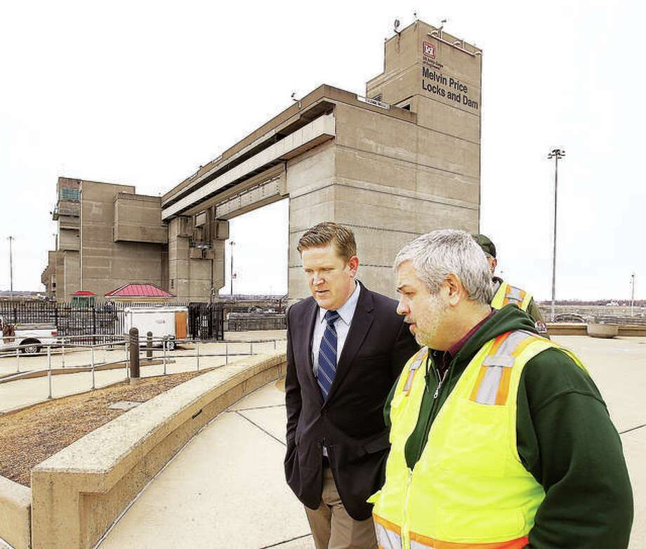 St. Clair County State's Attorney Brendan Kelly, left, talks with Andy Schimpf, right, Operations Manager for the Mississippi Rivers Project during January a tour of the Melvin Price Locks and Dam 26 in Alton. Illinois Clean Jobs Coalition and United Congregations of the Metro East, along with the Metro East Green Alliance and Sierra Club, are calling on elected officials and community leaders to host a community conversation on making clean energy more accessible. Photo:       John Badman | The Telegraph