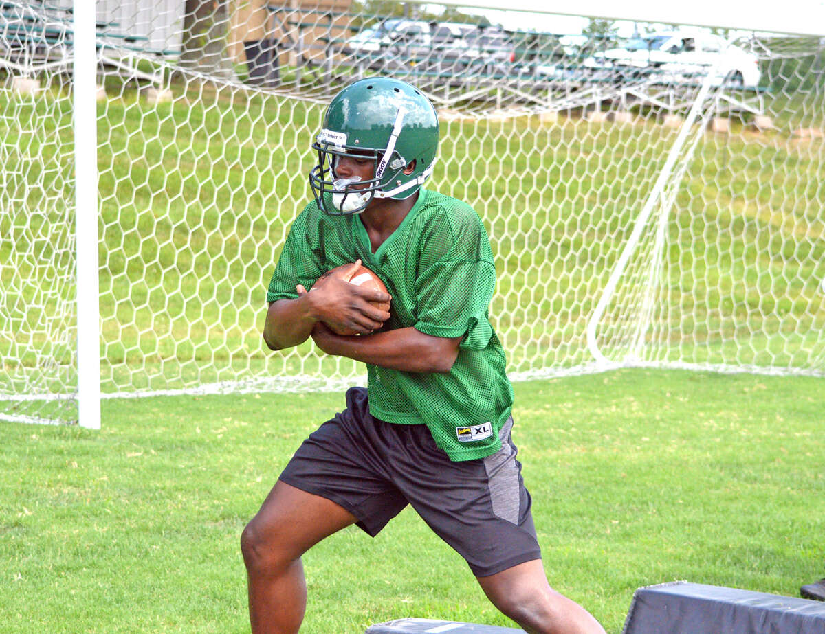 Metro-East Lutheran senior running back DaMonte Bean performs drills during the team's opening practice on Aug. 6.