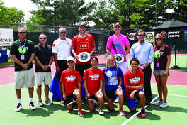 Standing from left to right are tournament director Dave Lipe, Paul Abert, EHS Principal Dennis Cramsey, Axel Geller, Sebastian Korda, EGHM President Joe Gugger and tournament associate director Emily Cimarolli. Kneeling are four ball kids.