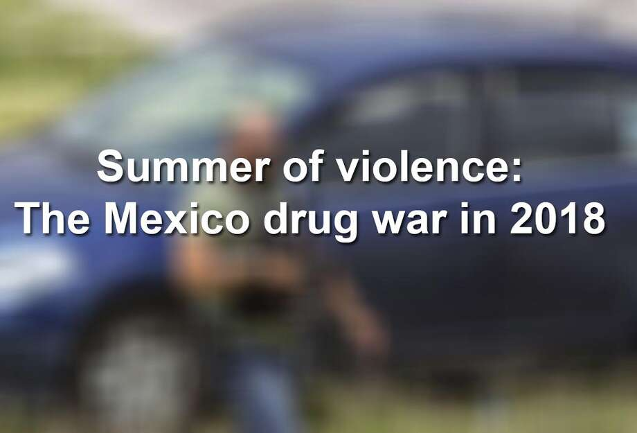 WARNING: GRAPHIC CONTENT. Several images in this slideshow may be inappropriate for some viewers. Homicides in Mexico rose by 16 percent in the first half of 2018, as the country again broke its own records for violence. Graphic images taken by Getty photographers that venture into crime scenes document a violent summer that has hit areas from Acapulco and Juárez, to Guadalajara and Cancún. Photo: ULISES RUIZ/AFP/Getty Images