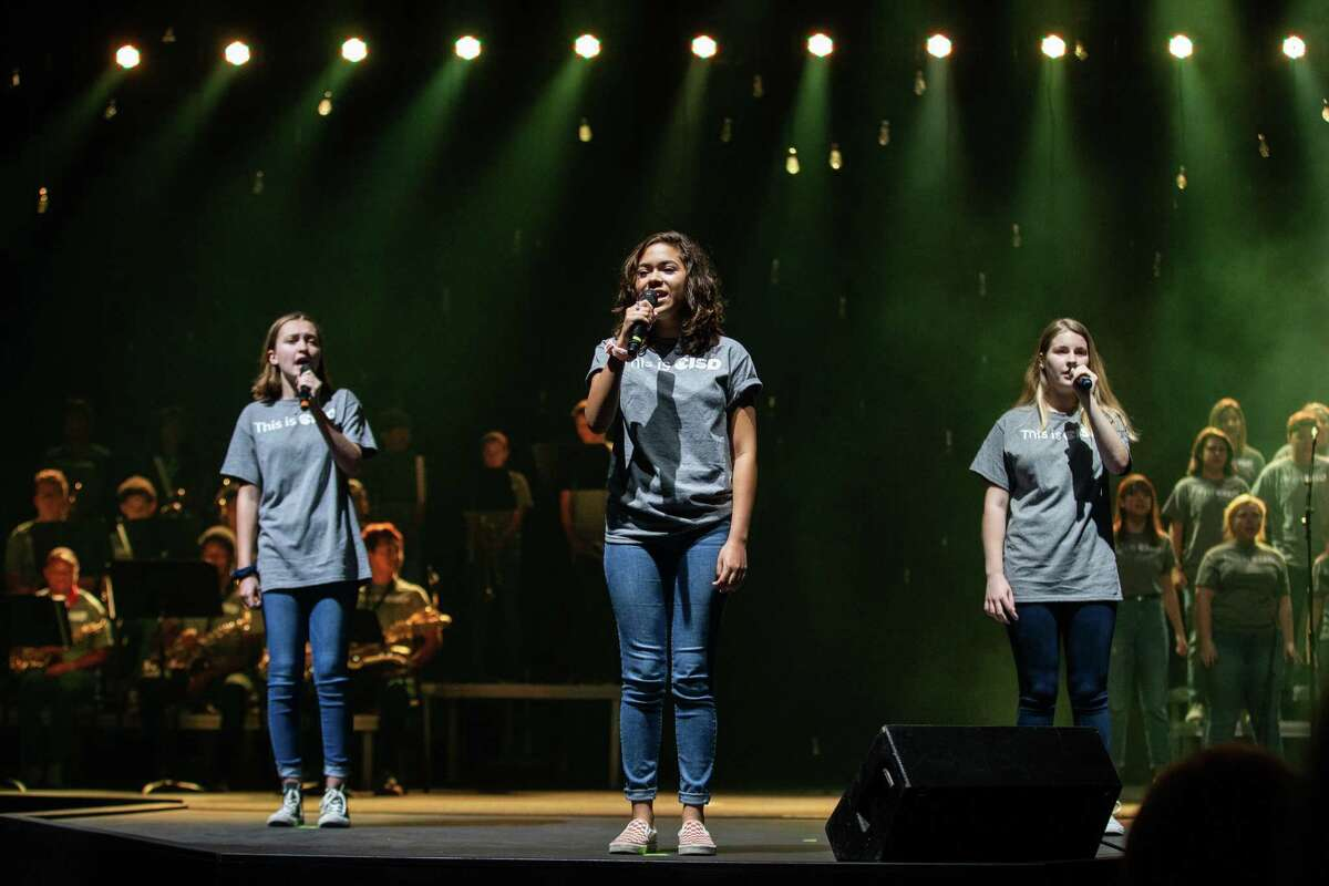 Students sing during Conroe ISD's Celebrate Our Schools Assembly on Monday, Aug. 13, 2018, at The Woodlands Church.