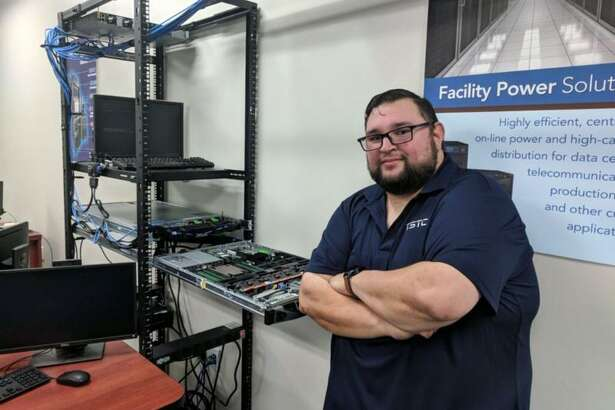 Rogelio Garcia graduates with an associate degree from Texas State Technical College's Cyber Security Technology program on Thursday, Aug. 16.