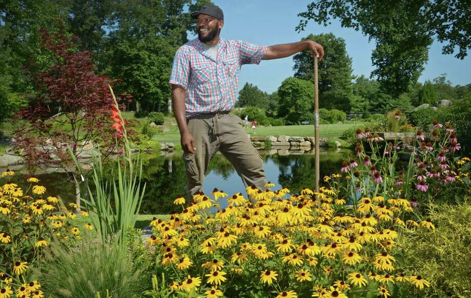 Oak Hills Park Horticulturalist Anthony Hylton at the park Friday, August 10, 2018, in Norwalk, Conn. Hylton has spent his career tending high-end gardens in Manhattan penthouses and a New Canaan estate before becoming the sole horticulturist at Oak Hills Park Golf Course, where he is in the process of creating a fountain garden designed to attract bees and butterflies at the public park and golf course. Photo: Erik Trautmann / Hearst Connecticut Media / Norwalk Hour