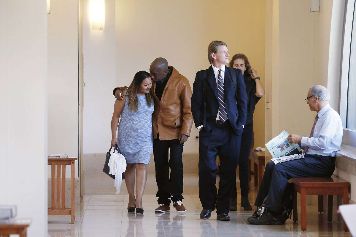 Dewayne Johnson (second from left), former groundskeeper for the Benicia Unified School District, walks with his wife Araceli Johnson (left) through Superior Court of California as they return to Department 504 during the Monsanto trial on Monday, July 23, 2018 in San Francisco, Calif.