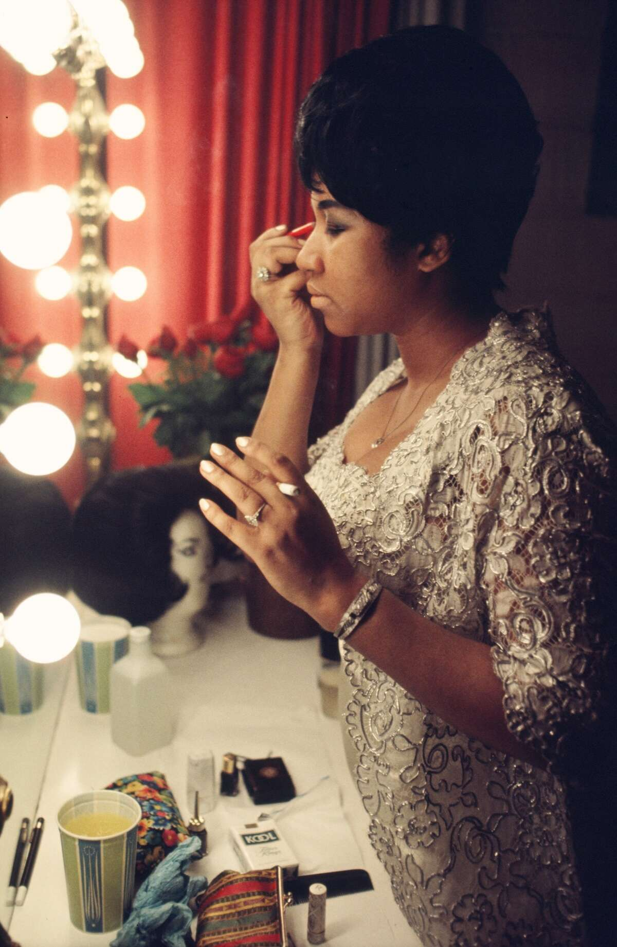 Singer Aretha Franklin fixes her makeup backstage before a performance at Symphony Hall in 1969, Newark, New Jersey. (Photo by:Walter Iooss/Getty Images)